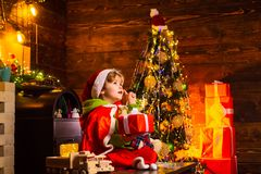 Believe in christmas miracle. Wish to meet santa claus. Winter holidays. Happy childhood. Merry christmas and happy new. Year. Adorable child play at home stock photos
