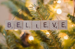 Believe Christmas Ornament. Letters spell out the word 'believe' in a handmade Christmas ornament royalty free stock photography