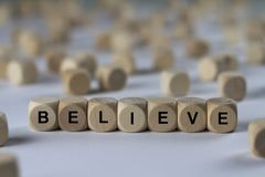 Believe - cube with letters, sign with wooden cubes Stock Photo