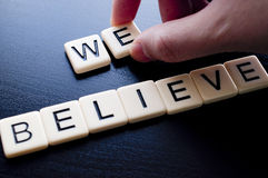 We believe on dark wood background Stock Images