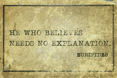 Believe Euripides. He who believes needs no explanation - ancient Greek philosopher Euripides quote printed on grunge vintage cardboard royalty free stock images