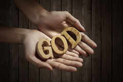 Believe in God. Man holding the word of God in hand Royalty Free Stock Photography