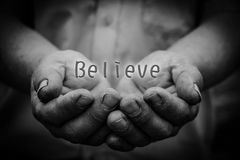 Believe in hand Stock Photo
