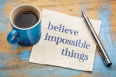 Believe impossible things text on napkin Stock Image
