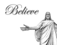 Believe in Jesus. Statute of Jesus with white background and word believe Stock Image