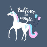Believe in magic. Calligraphic text with hand drawn unicorn and flowers. Cute illustration background royalty free illustration