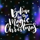 Believe in the magic of Christmas. Vector card design. Inspirational Christmas quote on dark vector background with bokeh lights and snowflakes Stock Photography