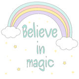 Believe in magic hand drawn motivational quote with cute cartoon rainbow, stars and clouds illustration Stock Image