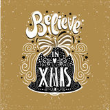 Believe in X mas- Christmas typographic poster, greeting card, print. Winter holiday saying.Hand lettering inside Christmas bell. Vector Illustration Royalty Free Stock Photos