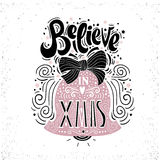 Believe in X mas- Christmas typographic poster, greeting card, print. Winter holiday saying.Hand lettering inside Christmas bell. Vector Illustration Stock Photo