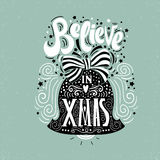 Believe in X mas- Christmas typographic poster, greeting card, print. Winter holiday saying.Hand lettering inside Christmas bell. Vector Illustration Stock Images