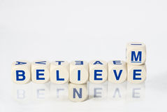 Believe in me spelled out in letter dice Royalty Free Stock Photo