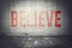Believe message on the wall Stock Images