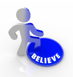 Believe - Person Steps Onto Button with Confidence Stock Images