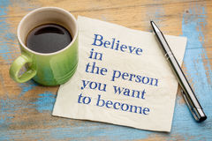 Believe in person you want to become. Believe in the person you want to become- handwriting on a napkin with a cup of espresso coffee Royalty Free Stock Image