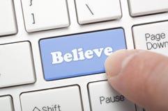 Believe. Pressing believe key on keyboard royalty free stock photos