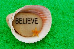 Believe Stone in Seashell Royalty Free Stock Images