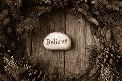 Believe in Text in the center of a Wreath Royalty Free Stock Image