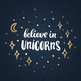 Believe in unicorns. The inscription  hand-drawing of white ink on the abstract night sky. Vector Image. It can be used for website design, article, phone case Stock Image