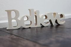 Believe wooden text Stock Photo