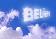 Believe. The word believe floating high above the clouds Stock Images