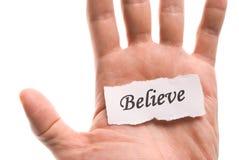 Believe word in hand stock images