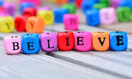 Believe word on table. Believe word on wooden table stock image