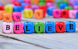 Believe word on wooden table Royalty Free Stock Images