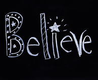 Believe written in chalk. The word believe hand doodled in chalk. Homemade Royalty Free Stock Photography