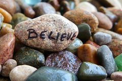 Believe written on a Stone. Inspirational word believe on a stone royalty free stock photography