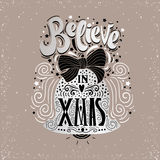 Believe in X mas- Christmas typographic poster, greeting card, print. Winter holiday saying.Hand lettering inside Christmas bell. Stock Photos