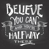 Believe you can motivation hand-lettering. Believe you can and you're halfway there. Motivational hand-drawn lettering on blackboard background with chalk vector illustration