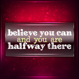 Believe you can and you are halfway there. Futuristic motivational background. Chalk text written on a piece of glass Royalty Free Stock Photo