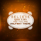 Believe you can and you are halfway there. Futuristic motivational background. Chalk text written on a piece of glass Royalty Free Stock Images
