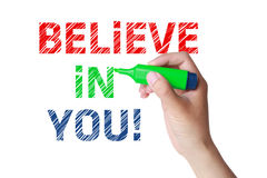 Believe in you. Concept and green marker in hand Royalty Free Stock Image