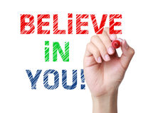 Believe in you. Concept and red marker in hand Royalty Free Stock Photos