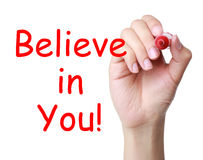 Believe in you. Concept and red marker in hand Stock Image