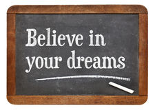 Believe in your dreams on blackboard stock photos