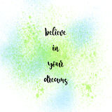 Believe in your dreams on blue and green spray background. Believe in your dreams. Inspirational quote on blue and green spray background Royalty Free Stock Photo