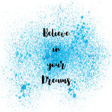 Believe in your dreams on blue spray paint background. Believe in your dreams. Inspirational quote on blue spray paint background Royalty Free Stock Photography