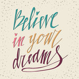 Believe in Your Dreams hand lettering inscription. Motivational poster with calligraphy Hand drawn lettering background. Inspiring. Quote Stock Photo
