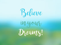 Believe in your dreams inspirational quote card. With handwritten text on blurred background Royalty Free Stock Photography