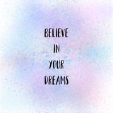 Believe in your dreams on pastel spray paint background. Believe in your dreams. Inspirational quote on pastel spray paint background Royalty Free Stock Photography