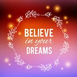 Believe in your dreams text on bokeh blurred background. Flower wreath, Hand drawn laurel. Festive greeting card Design. For invitations, quotes, blogs, posters Royalty Free Stock Photography