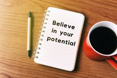 Believe in your potential. Inspirational quote on notepad - believe in your potential royalty free stock photo