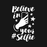 Believe in your selfie funny poster. Vector vintage illustration. Believe in your selfie motivational funny poster. Human hand holding a cell phone. Home decor royalty free illustration