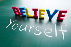 Believe yourself. Colorful words on blackboard royalty free illustration
