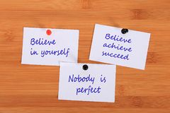 Believe in yourself. Believe achieve succeed. Nobody is perfect.  Note pin on the bulletin board. Believe in yourself. Believe achieve succeed. Nobody is Stock Image