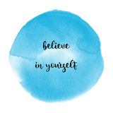 Believe in yourself on blue watercolor background. Believe in yourself. Inspirational quote on blue watercolor background Stock Photography
