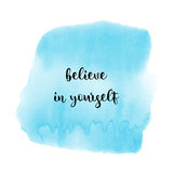 Believe in yourself on blue watercolor background. Believe in yourself. Inspirational quote on blue watercolor background Stock Photo